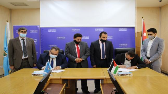 اتفاقية توظيف وتدريب بين جامعة الزرقاء وشركة المرجعية الذهبية